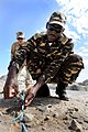 US Navy 110428-F-XM360-052 Namibian Defense Force (NDF) Sergeant Eugene M. Salionga attaches a non-electric blasting cap to the detonation priming.jpg
