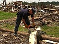 US Navy 110602-N-ZZ999-003 Chief Yeoman Mike Shea, assigned to the Virginia-class attack submarine USS Missouri (SSN 780), helps remove downed tree.jpg