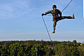 US Navy 110720-N-WW409-339 Lt. Ryan Ramsden, assigned to Explosive Ordnance Disposal Mobile Unit 5, rappels off a tower while training with members.jpg