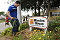 US Navy 110726-N-AU622-036 Interior Communications Electrician Fireman Donovan Cooper picks weeds from the property of Mission House.jpg