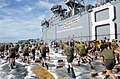 US Navy 111207-N-EK905-117 Sailors and Marines with the 11th Marine Expeditionary Unit (11th MEU) scrub down the flight deck of the amphibious ass.jpg