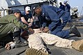 US Navy 111207-N-GH121-189 Sailors demonstrate administering proper first aid during a fire and mass casualty drill on the flight deck of the amphi.jpg
