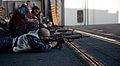US Navy 111207-N-OY799-174 Sailors fire M-16 rifles during a small arms gun qualification on aircraft elevator three aboard the Nimitz-class aircra.jpg