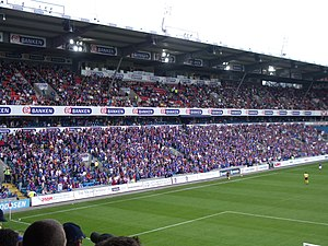 "Vålerenga Fotball - Vålerenga supporters in the stand nicknamed ""The West Bank"""
