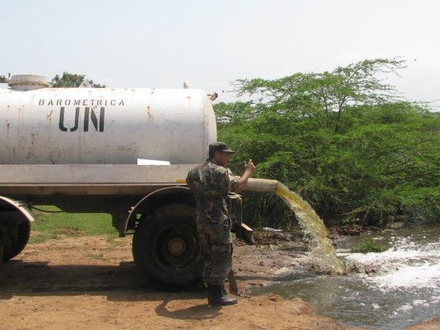Unsafe disposal of faecal sludge or sewage in Haiti (6458176073)