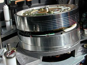 Magnetic tape - A VHS helical scan head drum. Helical and transverse scans made possible to increase the data bandwidth to the necessary point for recording video on tapes, and not just audio.