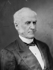 formal photographic portrait of white haired man