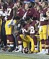 Washington Redskins National Anthem Kneeling (37301887651) (cropped) (cropped).jpg