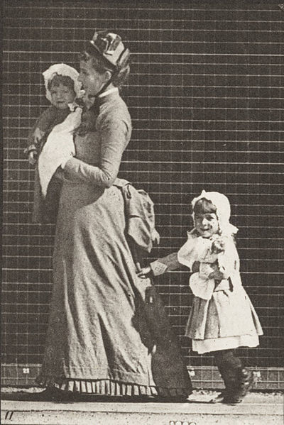 File:Woman walking, carrying a child and turning around; another child holding on to the woman's dress (rbm-QP301M8-1887-052a~11).jpg