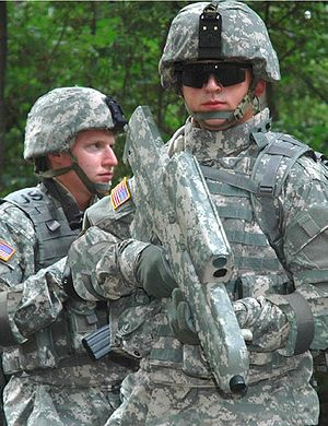 XM25 CDTE - A U.S. soldier wielding an XM-25 decorated in the Universal Camouflage Pattern