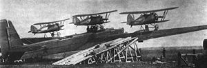 Zveno project - Zveno-2: Tupolev TB-3 and three Polikarpov I-5. Also visible is the ramp for loading the fighters. The centerline aircraft was hoisted on top of the fuselage by hand.