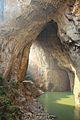九洞天 A very huge rock gate in Bijie (The small orange dot is a heap of many life vests) - panoramio.jpg