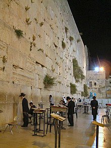 Jews praying at the Western Wall in the evening