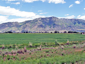 08-64-City of Elwood,UT,with,Mendon Peak in background as seen from I-15. June 8,2008.jpg