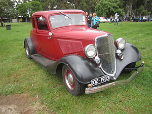 1932 Ford - 1933 Ford Model B Standard 5 window Coupe. This car has incorrect wheels. Painted Window frame indicates a Standard. While twin chromed horns and cowl lamps were included with Deluxes, they proved a popular option for Standard models.