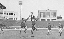 Players contest a mark at the 1933 Australian Football Carnival, at the Sydney Cricket Ground. The teams are Victoria and Tasmania. (Photographer: Sam Hood.)