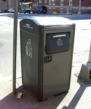 Compactor - A solar trash compactor on a residential corner in Jersey City, New Jersey.