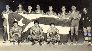C.S.D. Municipal - Municipal team that participated in the 1948 tournament in Cuba, holding the flag of the host country
