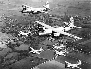 "RAF Rivenhall - Formation of Martin B-26Bs of the 397th Bomb Group. Closest two aircraft are B-26B-55-MA S/N 42-96137 (9F-Y) and 42-96191 (9F-N) ""Milk Run Special"" of the 597th BS, 397th BG, 9th AF. The other B-26's are from the 598th Bomb Squadron.  42-96137 was shot down on 13 May 1944. 42-96191 was shot down on 24 June 1944. Photo taken before D-Day, as the Marauders are not painted with invasion stripes"