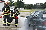 788th Civil Engineer Fire Department firefighters hose down car in August 4 2017 training exercise.jpg