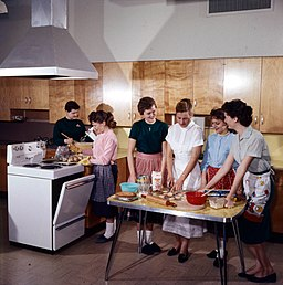 A Home Economics class receiving instructions on cooking. Ottawa, Ontario, 1959
