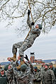A Junior Reserve Officers' Training Corps cadet navigates an obstacle course at the 7th annual Raider Challenge.jpg