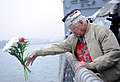 A Pearl Harbor survivor tosses flowers. (8264508736).jpg