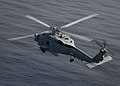 A Sea Hawk helicopter maneuvers over the South China Sea. (8782334387).jpg