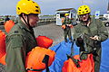 A U.S. Airman with the 305th Air Mobility Wing looks at the straps of a flotation device during water survival training near Coast Guard Station Barnegat Light, N.J., Aug. 18, 2011 110818-F-CA540-011.jpg
