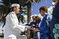 A U.S. Sailor presents a U.S. flag to the widow of Pearl Harbor survivor Coxswain Gale D. Mohlenbrink after a ceremony at the USS Utah Memorial on Ford Island in Pearl Harbor, Hawaii, Oct. 29, 2013 131029-N-IU636-289.jpg