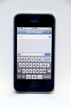 A White iPhone 3G displaying virtual keyboard in portrait mode.jpg