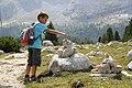 A boy on a hiking break in the Dolomites.jpg