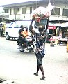 A man carrying loads in Lagos.jpg