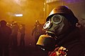 A protester wearing breathing gas mask. Clashes between protesters and interior troops persist. Euromaidan Protests.jpg