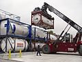 A stacker operator maneuvers an intermodal (ISO) container filled with hydrolysate..jpg