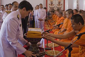 Kathina - Former Prime Minister Abhisit Vejjajiva of Thailand offers Kathina robes to monks at 2010 Kathin.