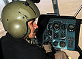 Afghan MI-17 Instructor Pilot trains student for first time (5531255619).jpg