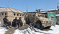 Afghan Uniform Police officers provide security at a checkpoint next to a U.S. Army mine-resistant, ambush-protected vehicle Feb 120213-A-BZ540-046.jpg