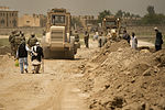Afghan men walk along a roadway where U.S. Air Force pavements and construction equipment personnel assigned to the 455th Expeditionary Security Forces Group and the 577th Expeditionary Prime Base Engineer 130613-F-YL744-226.jpg