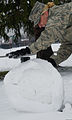 Airman 1st Class Lindsay Helbig, a ceremonial guardsman with the U.S. Air Force Honor Guard and assigned to the 11th Wing Protocol, makes a snowman, March 25, 2013, at Joint Base Andrews (JBA), Md 130325-F-MG591-022.jpg