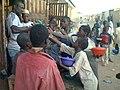 Almajiri mendicants stretching hands to collect sweet as Sadaka. Many people in Hausa land give 'Sadaka' to almajirai on daily basis seeking Divine reward and protection.jpg