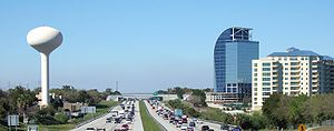 "Altamonte Springs, Florida - Skyline of Altamonte Springs viewed from Interstate 4, with the unfinished Majesty Building (often called ""the Eyesore on I-4"") in the background."