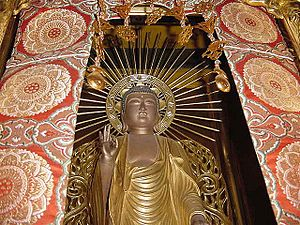 Honzon - An example of Butsuzō Honzon in the Pure Land tradition featuring Amida Buddha.