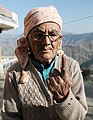 An elderly voter showing her marked finger after casting her vote at a polling booth of Theog, Distt. Shimla, during the Himachal Pradesh Assembly Election on November 04, 2012.jpg