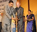 Anand Sharma lighting the lamp to inaugurate the WTO's Regional Trade Policy Course, in New Delhi on September 05, 2011. The WTO Director General, Mr. Pascal Lamy is also seen.jpg