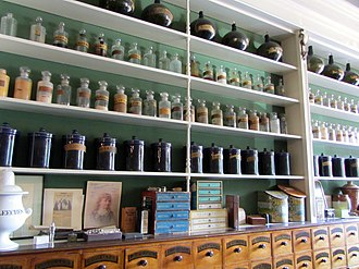 Niagara Apothecary - Drawers, and shelving housing various bottles and other artefacts