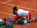 Andy Murray receives medical treatment.jpg