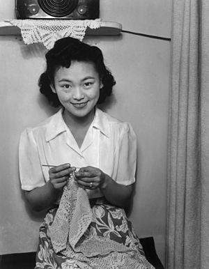 Crochet - Filet crochet by an internee at Manzanar War Relocation Center, 1943.  Photograph by Ansel Adams