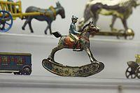 Antique tin toy jockey on rocking horse (25868118450).jpg