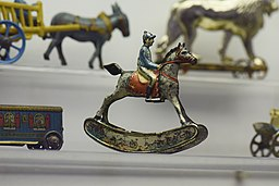 Antique tin toy jockey on rocking horse (25868118450)